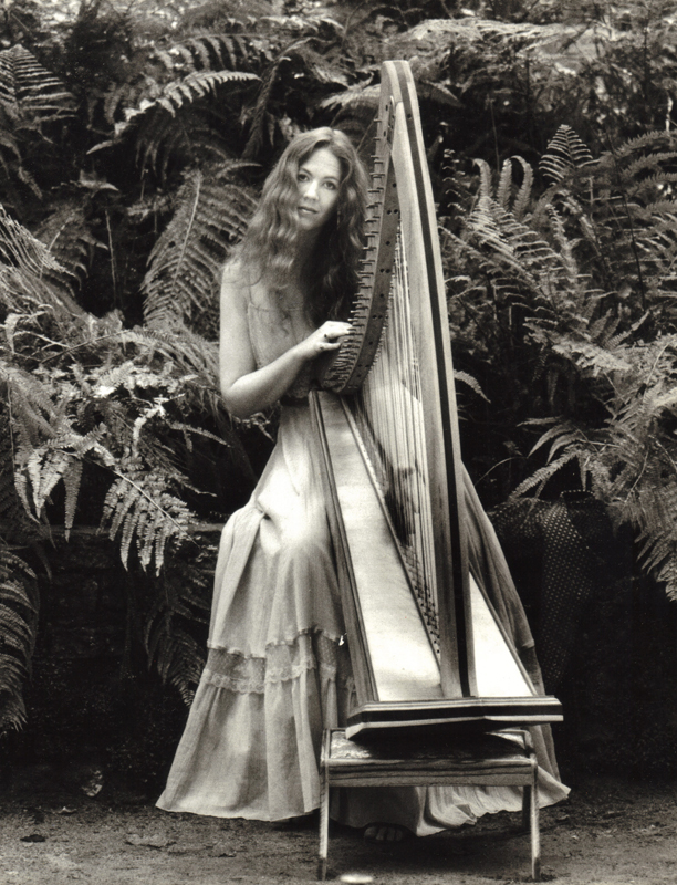 Bobbie Jo with Triple strung Celtic Harp in Fern Garden